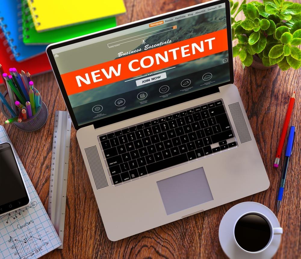 New Content on Laptop Screen. E-commerce Concept..jpeg